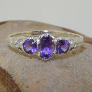 ornate silver amethyst trilogy ring