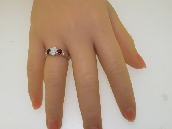 victorian opal and garnet ring on hand