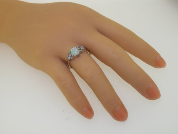 opal engagement ring on hand