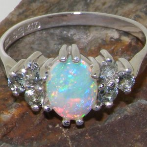 gold opal and aquamarine engagement ring